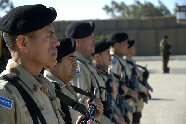 A row of soldiers from El Salvador's Cuscatlán Battalion, ninth rotation, stand at the position of port arms during the battalion's transfer of authority ceremony Feb. 22 at Forward Operating Base Delta. The ninth rotation developed and implemented 25 civic-action projects, provided $2.1 million in aid affecting more than 324,000 people during their six-month tour to the Wasit Province.