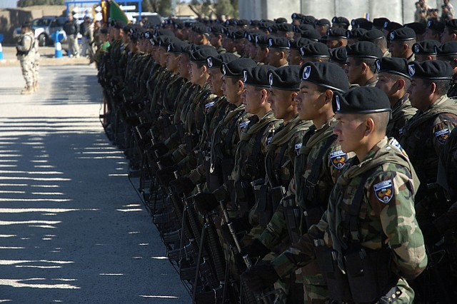 The El Salvadorian soldiers of the Cuscatlán Battalion, 10th rotation, stand at parade rest during the unit's transfer of authority ceremony Feb. 22 at Forward Operating Base Delta.  The 280-man battalion is a mix of special forces, infantry, engineer and combat service support soldiers doing six-month tours in support of Operation Iraqi Freedom.