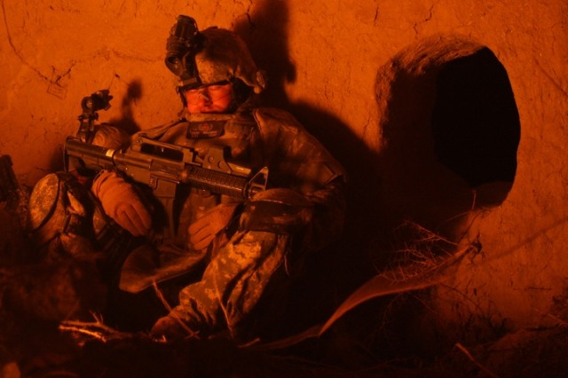 An Explosive Ordnance Disposal technician attached to the 1st Brigade Combat Team, 101st Airborne Division (AA) gets some rest after Operation Helsinki near the Bichigan Peninsula, Iraq.