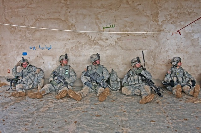 Soldiers from the 1st Squadron, 32nd Cavalry Regiment, 1st Brigade Combat Team, 101st Airborne Division (AA) take time for chow during Operation Helsinki near the Bichigan area of the Salah ad Din province, Iraq.