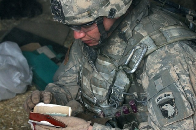 Staff Sgt. Tommy Pafford, 1st Squadron, 32nd Cavalry Regiment, 1st Brigade Combat Team, 101st Airborne Division (AA), finds suspicious documents hidden in a barn during Operation Helsinki.