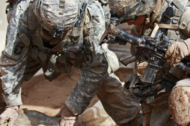 Soldiers with 1st Squadron, 32nd Cavalry Regiment, 1st Brigade Combat Team, 101st Airborne Division (AA) search for weapons near the Bichigan area of the Salah ad Din province.