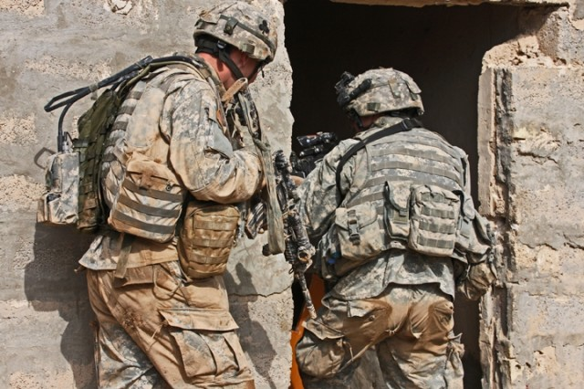 Soldiers from 1st Squadron, 32nd Cavalry Regiment, 1st Brigade Combat Team, 101st Airborne Division (AA) enter a suspected Al Qaeda safehouse during Operation Helsinki near the Bichigan area of the Salah ad Din province.