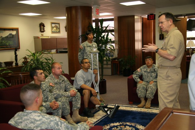 TRIPLER ARMY MEDICAL CENTER, Hawaii -- Chairman of the Joint Chiefs of Staff Adm. Mike Mullen addresses wounded Soldiers assigned to the Warrior Transition Unit here Feb. 20.  Mullen's visit to Tripler was part of his tour of military installations across the island of Oahu.