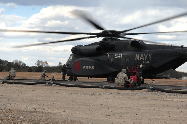 58th Quartermaster Company Soldiers from Fort Lee, Va., 'hot refuel' a U.S. Navy aircraft during Exercise Southbound Trooper Feb. 19 at the Virginia National Guard installation.