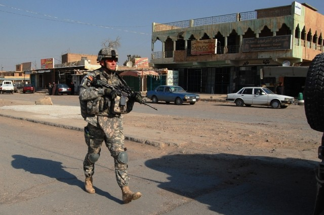 A 101st Airborne Division (Air Assault) Soldier and Kentucky state native, Maj. Jason Tussey, patrols in downtown Bayji, Iraq during Operation Iraqi Freedom.