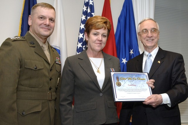 From left to right: Carol King, Army Material Command, Deputy Secretary of Defense Gordon England and Marine Corps Gen. James E.