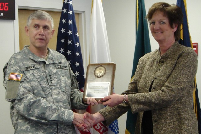 Gen. Griffin presents Lean Six Sigma greenbelt certification to Kathy Ryan during a recent stop at Deseret Chemical Depot.