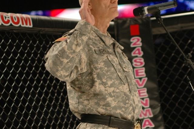 Brig. Gen. Daniel I. Schultz, commander of the 143rd Sustainment Command (Expeditionary), administers the oath of enlistment to Tampa area recruits during the Xtreme Fighting Championship Mixed Martial Arts Salute to Our Armed Forces held March 2, 2008 at the St. Petersburg Times Forum in Tampa, Fla.