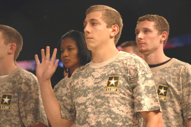 Tampa, Fla., area recruits receive the oath of enlistment during the Xtreme Fighting Championship Mixed Martial Arts Salute to Our Armed Forces held March 2, 2008 at the St. Petersburg Times Forum in Tampa, Fla.