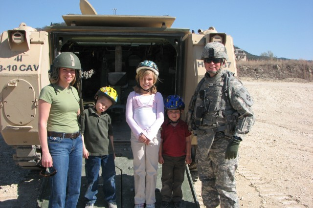 Maj. Colin Wooten and his Family pose during the 8th Squadron, 10th Cavalry Regiment Family Day, Feb. 9 at Jack Mountain Range on Fort Hood, Texas.