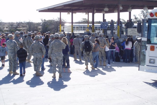 Soldiers greet their Families as the buses unload following the safety brief during the 8th Squadron, 10th Cavalry Regiment Family Day, Feb. 9 at Jack Mountain Range on Fort Hood, Texas.