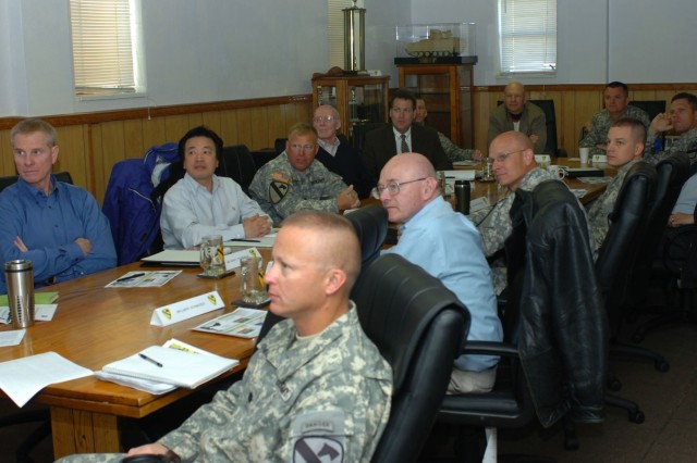 Army Science Board members and senior leadership from the 1st Brigade Combat Team, 1st Cavalry Division watch a video highlighting the brigade's recent deployment to Iraq during a meeting at Fort Hood, Texas Feb. 27.