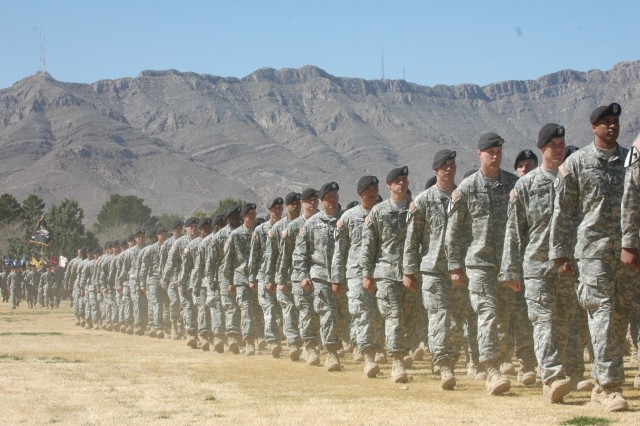 """Soldiers from the 4th Brigade Combat Team, 1st Armored Division, march past the review stand during a reflag ceremony at Noel Field, March 4. The ceremony marked the end of the 1st Cavalry Division's time at Fort Bliss, Texas, and the beginning of the 1st Armored Division. """""""