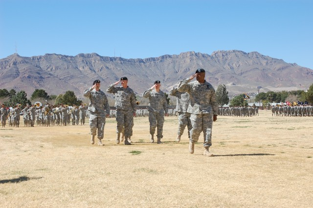 """Col. Stephen Twitty, commander, 4th Brigade Combat Team, 1st Armored Division, leads the Highlander Brigade in pass and review during a re-flag ceremony March 4 at Noel Field on Fort Bliss, Texas The new brigade's name was chosen for its location in the highlands of west Texas."""""""
