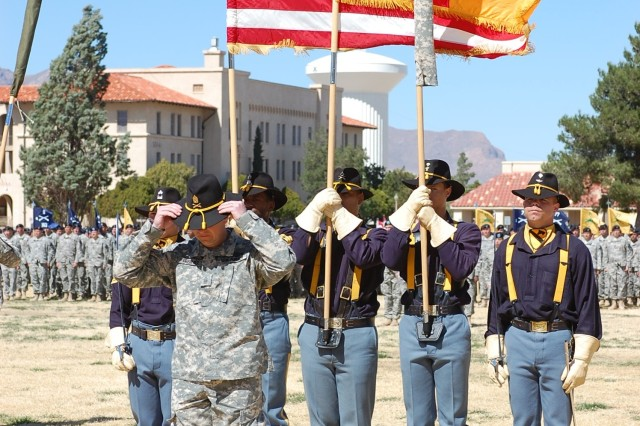 """Command Sgt. Maj. Stephan Frennier, 4th Brigade Combat Team, 1st Armored Division prepares to remove his Stetson to signify the end of the 4th BCT, 1st Cavalry Division at Fort Bliss, Texas. The Long Knife Brigade re-flagged to the Highlander Brigade during a noon ceremony at Noel Field March 4. """""""
