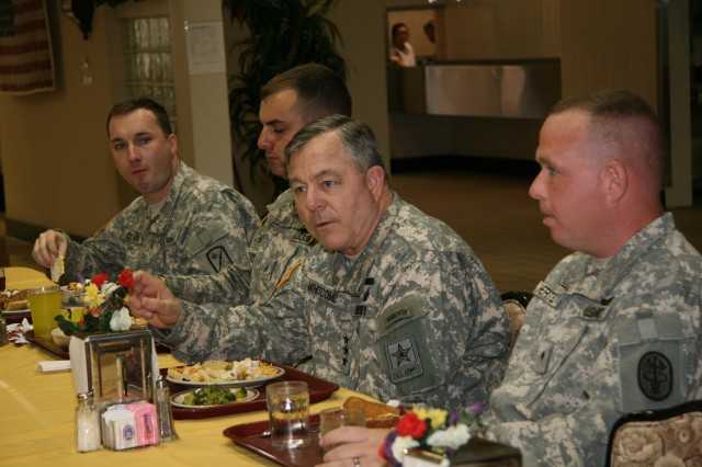 SCHOFIELD BARRACKS, Hawaii -- U.S. Army Inspector General Lt. Gen. R. Steven Whitcomb talks candidly while eating lunch with Soldiers from Tripler Army Medical Center's Warrior Transition Unit at the dining facility here March 5.Whitcomb spoke with WTU Soldiers without unit cadre present to specifically address care and welfare issues, just two weeks after Joint Chiefs of Staff Chairman Adm. Mike Mullen visited with troops. Whitcomb echoed Mullen's sentiment voicing how impressed he is with Tripler's WTU and what the command is doing here to take care of Warriors in Transition. U.S. Army photo by Kevin Downey.