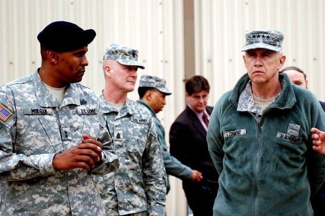 Maj. Gen. John W. Morgan III, commander, 2nd Infantry Division, speaks with Gen. Benjamin S. Griffin, commanding general, Army Materiel Command and Command Sgt. Maj. Jeffery Mellinger, Army Materiel Command, during Griffin's visit to 2ID Feb. 22.