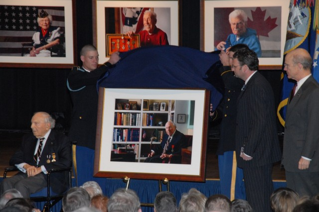 Two honor-guard Soldiers help unveil David DeJonge's portrait of Frank Buckles, the last American World War I veteran during a Pentagon ceremony March 6. Nine portraits of World War I veterans, including Buckles, will remain on permanent display at the Pentagon. Buckles is seated as DeJonge and Secretary of the Army Pete Geren (right) look on.