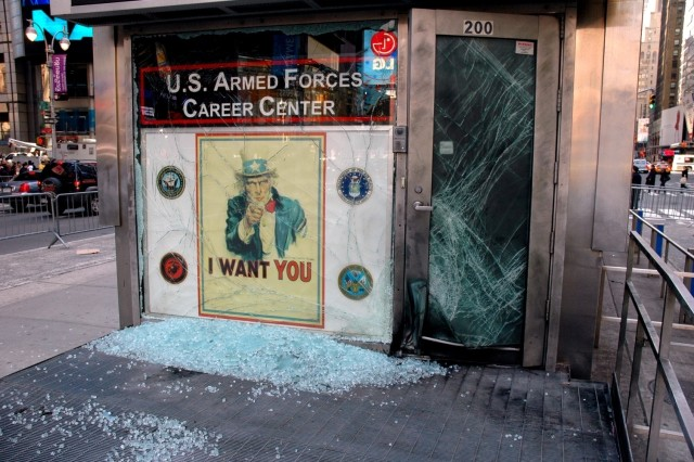 An improvised explosive device blasted the entrance to the U.S. Armed Forces Career Center in Times Square at approximately 3:45 a.m. Thursday.