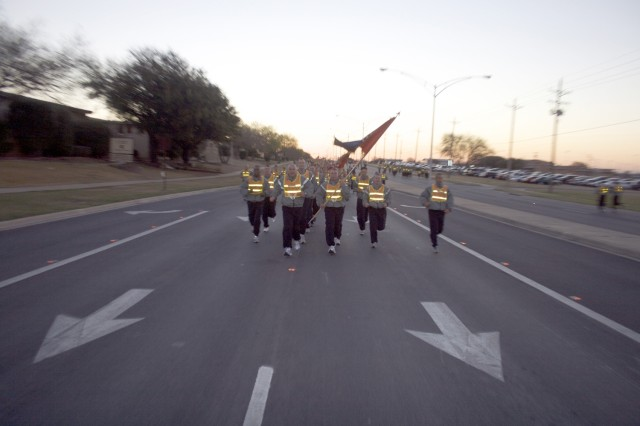 Col. Philip Battaglia, the 4th Brigade Combat Team, 1st Infantry Division, commander, leads his Soldiers during a brigade run March 5. The brigade re-flagged to join the 1st Cavalry Division March 7.
