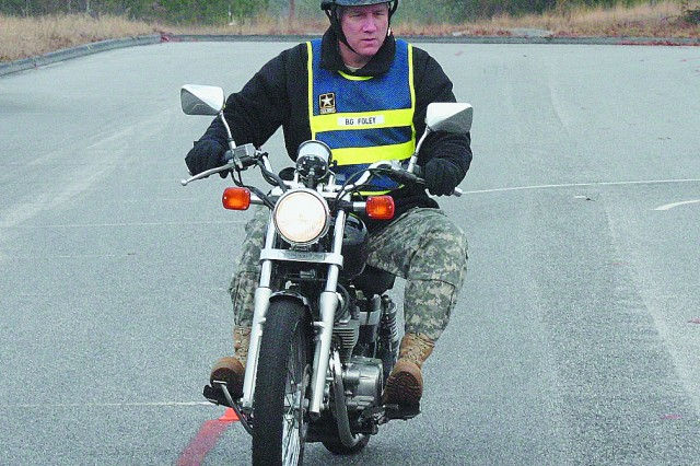 Brig. Gen. Jeffrey Foley, U.S. Army Signal Center and Fort Gordon commanding general, completes one of the 17 riding exercises required in the Basic Rider Course on post to earn his Motorcycle Safety Foundation course card recently. Photo by Bonnie Heater