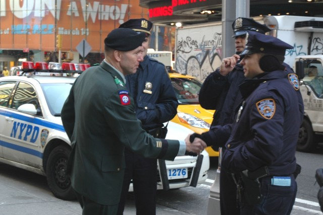 Members of the NYPD are greeted by Lt. Gen. William B. Caldwell IV, commanding general, Combined Arms Center and Fort Leavenworth, KS, during his visit to the Times Square Military Recruiting Station in New York City March 10.
