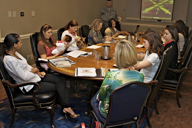 Lt. Col. Timothy Daugherty, 5th Battalion, 82nd Field Artillery Regiment commander, gives a presentation to military Family members during the battalion's pre-deployment offsite training in Austin. The 4th Brigade Combat Team, 1st Cavalry Division, is scheduled to deploy to Iraq this summer.
