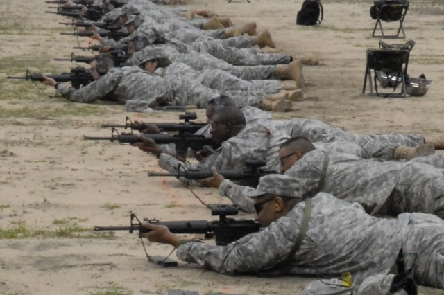 Fort Jackson drill sergeants line up to fire from 300 meters Tuesday at Argentan Range during Asymmetric Warfare Group training. The course reinforces Basic Rifle Marksmanship skills and is intended to give drill sergeants tools they can bring back to training their Soldiers.