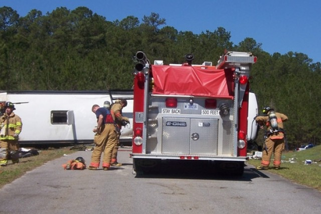 Fort Rucker and Wiregrass area firefighters respond to a bus accident at Mateson Range Sunday, March 9. Thanks to the community response effort, within one hour of the accident, all 23 wounded Marines on board had been taken to local medical facilities.