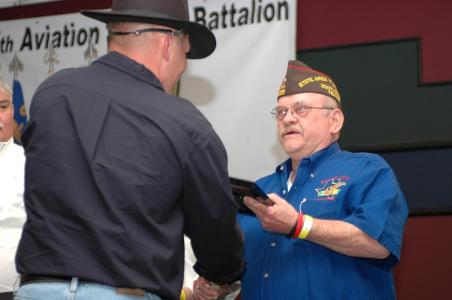 """Baraboo, Wis., native Lt. Col. Mark Hirschinger (left), the commander of 615th Aviation Support """"Cold Steel"""" Battalion, 1st Air Cavalry Brigade, 1st Cavalry Division, presents Harry Munn, commander of Veterans of Foreign Wars Post 6008, with the Order of the Spur during a welcome home and combat spur ceremony March 8. Post 6008 sponsored Cold Steel during their 15-month deployment to Iraq as well as the night's events."""