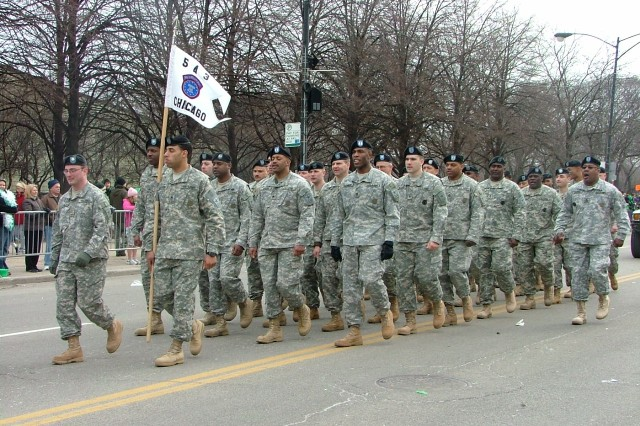 Sgt. 1st Class Clifford Brown, far right, calls cadence as Soldiers from the U.S. Army Chicago Recruiting Battalion and the U.S. Army Reserve 416th Theater Engineer Command march in Chicago's 53rd annual St. Patrick's Day parade Saturday March
