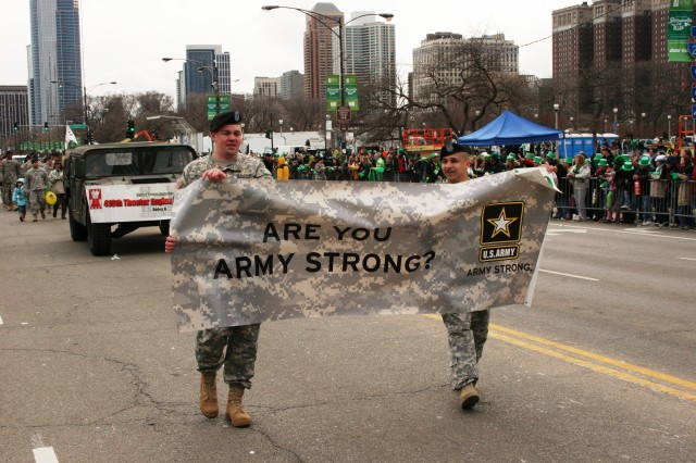 "Staff Sgt. Jacob Kerly, left, and Sgt. Miguel Cortes of the U.S. Army Chicago Recruiting Battalion display the ""Army Strong"" banner to the more than 200,000 spectators at  the 53rd annual city of Chicago St. Patrick's Day parade Saturday March 15, 2008. """