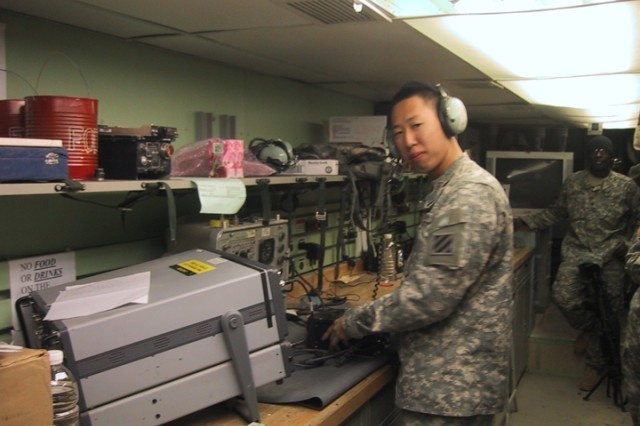 Spec. Marcelo Jang prepares an aviation radio for testing and repair in an AN/ASM-189 electroincs van. Jang, an avionics communications equipment repairer, is a member of the Avionics Repair Section, Bravo Company, 603rd Aviation Support Battalion, serving in Southwest Asia.