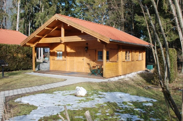 Not exactly roughing it, the larger deluxe cabin shown here is as roomy as home, with the added features of a bathroom and kitchenette.  All campsites for Armed Forces Recreation Center playground in Garmisch, Germany, come with a barbecue grill