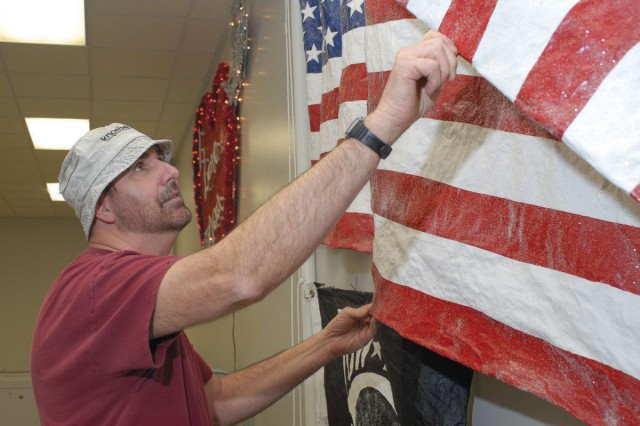 American and POW MIA flags hang in Building 4.  Stretch created the flags in 2005 to show partiotism and support for our troops.