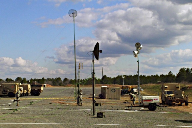 Soldiers from 4th Brigade Combat Team, 1st Cavalry Division, set up a communication array at Forward Operating Base Sword in Fort Polk's Joint Readiness Training Center March 11. The brigade's communication systems allow key leaders to stay in contact during combat situations.
