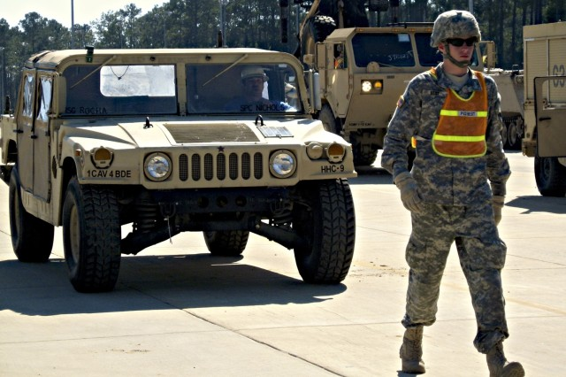 Soldiers in the 1st Cavalry Division's new 4th Brigade Combat Team move vehicles to the Joint Readiness Training Center from the Fort Polk, La., railhead March 12.