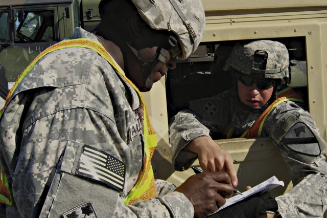 Soldiers in the 1st Cavalry Division's new 4th Brigade Combat Team move vehicles to the Joint Readiness Training Center from the Fort Polk railhead, La., March 12.