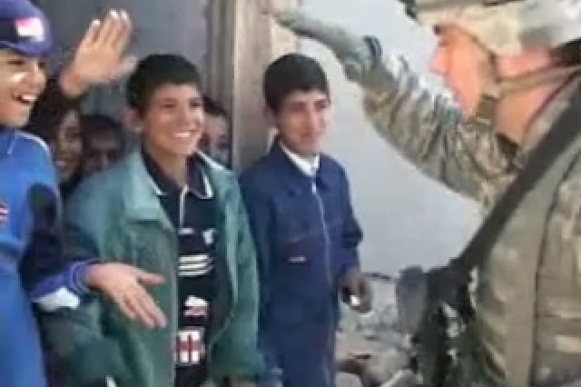 Soldier and Iraqi Children