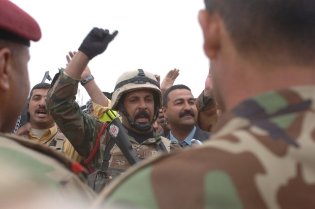 Members of the Gharani, Mamouri and Khazraj tribes sing and dance, celebrating the return of two displaced groups - the Mamouri and Khazraj tribes - March 11 just outside Patrol Base Copper, Iraq. ""