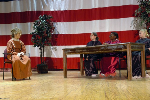 Students from Saegert Ranch Elementary School (Left to Right) Brittany Colon, Vivian Medina, Nadia Carter and Savannah Morelock put on a skit for an audience during a Women's History Month celebration held at Fort Hood's Houze Theater March 13. Colon, who played the 19th century's women's rights activist Susan B. Anthony, is being trialed for impersonating a man in order to vote.
