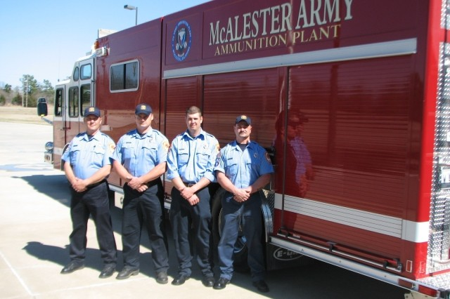 Local heroes-Four firefighters from McAlester Army Ammunition Plant rescued a fellow employee, Ronnie McDonald, 70, from rising waters after he drove his van drove into the unseen danger during a pre-dawn drive to work. Standing in from of their rescue truck are:  Izzy Pickens, Savanna; Tracy Allen, Wilburton; Lucas Mass, Hartshorne and Caleb Pierce, Kiowa. (U.S. Army photo by Mark Hughes)