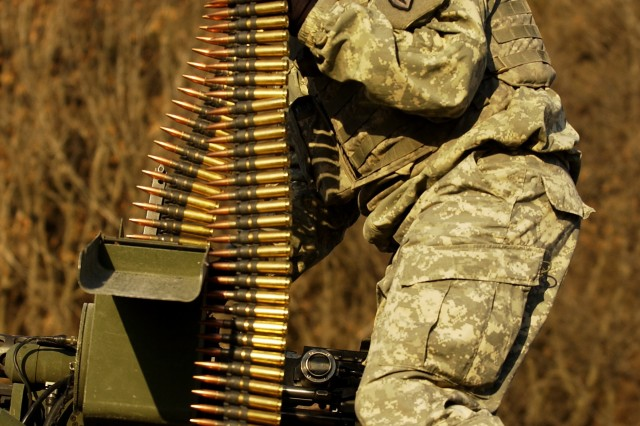 Cpl. Jeffrey MacDonald, with the 25th Infantry Division, loads .50-caliber ammunition in his Stryker vehicle during Exercise Key Resolve/Foal Eagle 2008 at the Rodriguez Live Fire Range in South Korea.