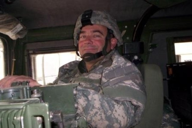 Sgt. Troy Lewis prepares to conduct a mission in Baghdad Dec. 6, 2006. Lewis recently returned home after a 15-month deployment with Company G, 3rd Battalion, 82nd Field Artillery, 2nd Brigade Combat Team, 1st Cavalry Division.