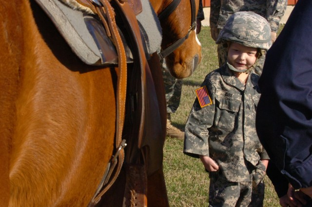Staff Sgt. Gaven Cox gets to know the horse he is about to ride at the 1st Cavalry Division's Horse Detachment right outside Fort Hood, Texas, March 20.