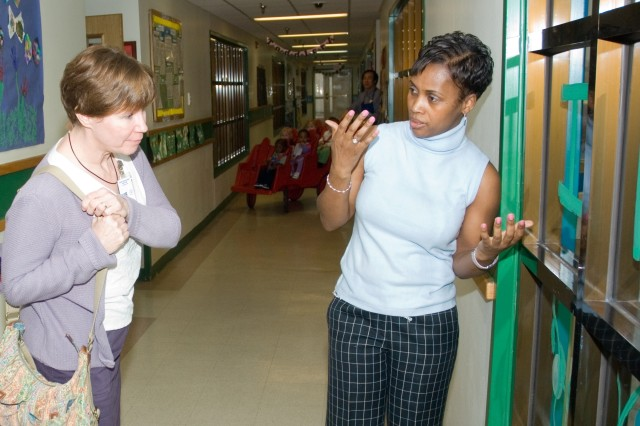 Claudette Mohn (right), Yongsan Child Development Center coordinator, explains how the CDC operates to Donna Winzenried March 13.