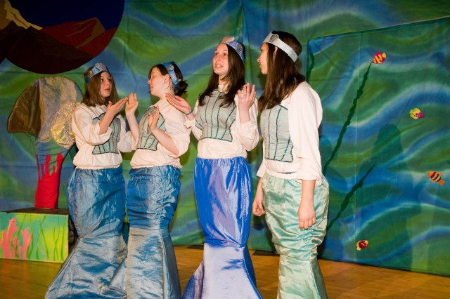 """(Left to right) Lexi Haddock, Elizabeth Riehle, Nikki Haddock and Katherine Bloss perform as mermaids in the Missoula Children's Theatre production of """"Little Mermaid"""" March 15 at Seoul American High School auditorium."""