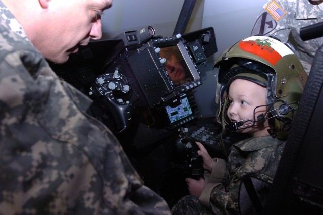 Gaven Cox maneuvers a virtual Apache helicopter on Fort Hood, Texas, March 20. After successfully completing the training he was deemed an honorary gun pilot.