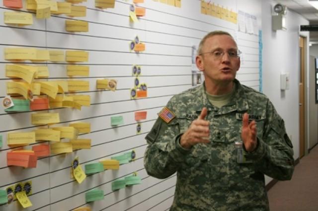 Maj Gen. Robert M. Radin explain the E-Board